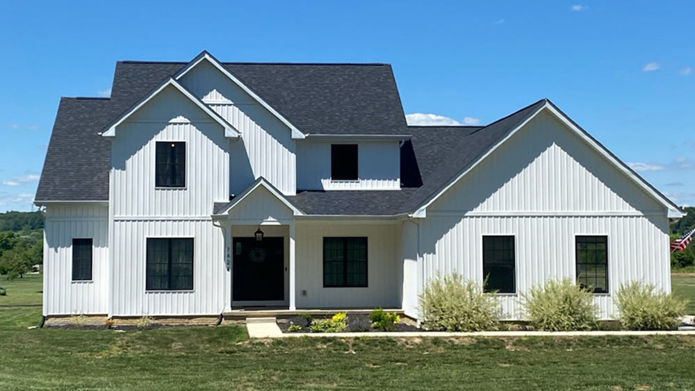 Farmhouse-style custom home on Bloom Carrol land, available now in Zwayer Woods development